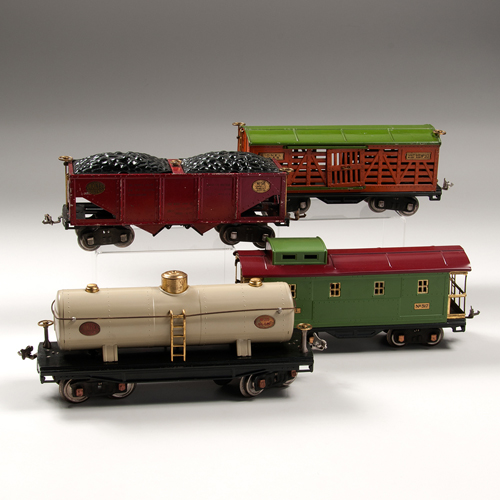 Lionel No. 215 Ivory Oil Car and 500 Series Freight Cars, Lot of Four